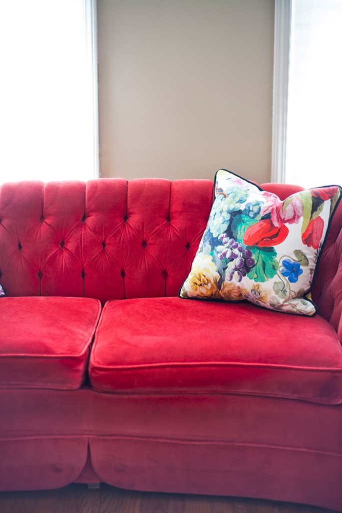 Red velvet tufted sofa chesterfield sofa iconic furniture for Ava nailhead chaise