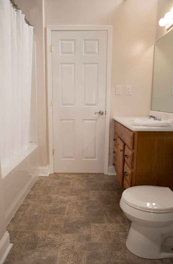 A blogger vs builder grade bathroom makeover the makerista for Bathroom builders